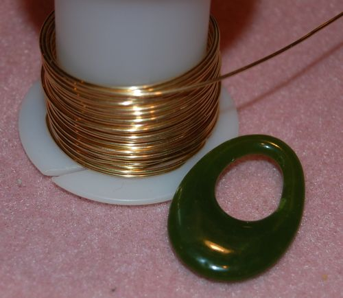 Jewelry wire wrapping techniques for pendant bails jade pendant and spool of 20 gauge wire aloadofball Images