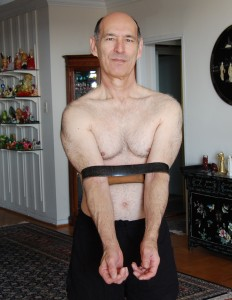 Belt to stablilize Mayurasana yoga posture